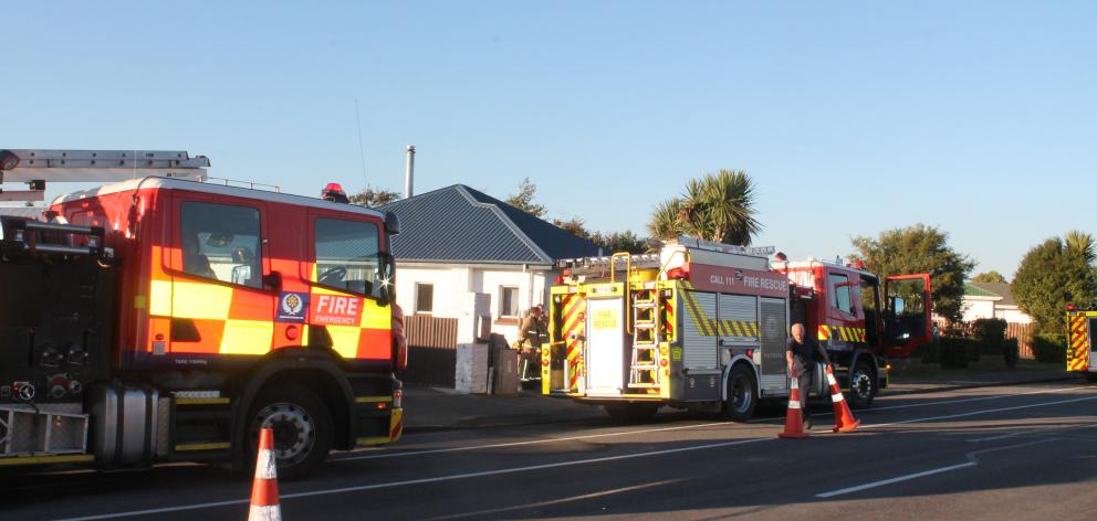 Fire crews were called to a Tweed St property in Invercargill this afternoon after a family came home to find smoke coming from an upstairs bedroom. Photo: Abbey Palmer