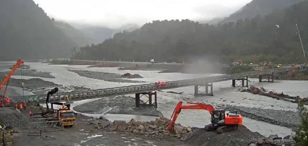 Work continues on the Bailey bridge across the Waiho River yesterday.PHOTO: NZTA