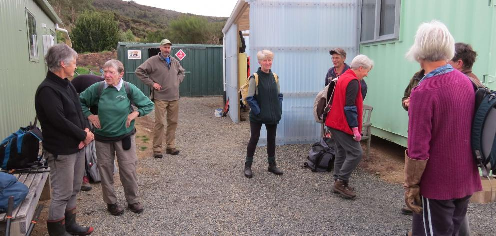 Teams of volunteers gather at base to get their instructions for the day. PHOTO: ALYTH GRANT