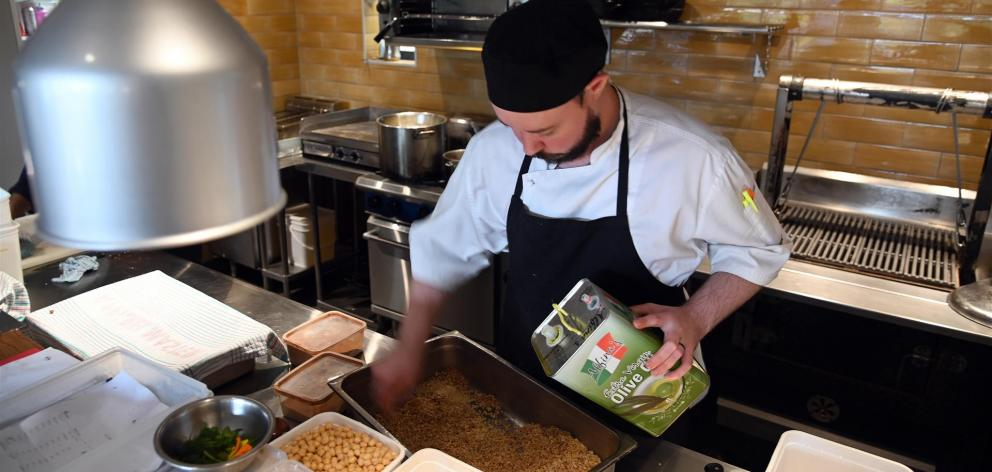 Chef Logan Wilson prepares for the reopening in the new kitchen.