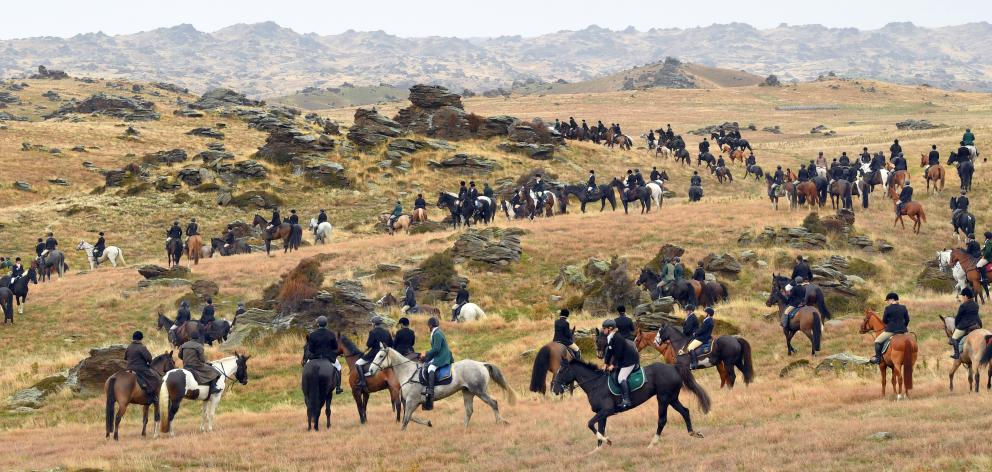 Riders attending the opening hunt of Central Otago Hunt's 30th anniversary hunt week celebrations converge amid the rocky landscape near Moa Creek in the Ida Valley yesterday. Left: Glynne Smith, riding Jim, has been hunt master for 30 years. Photos: Step