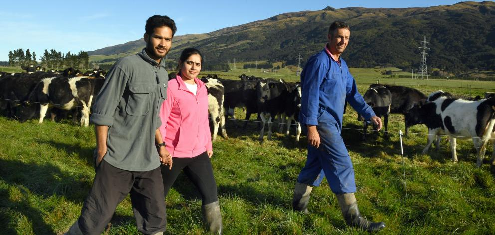 Harrie and Pawan Chander are able to stay in New Zealand where Mr Chander works for Woodside...