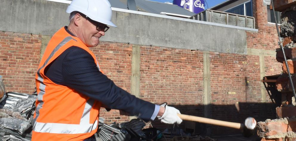 """Dr David Clark """"helps"""" with the demolition of the building on the former Cadbury's car park site..."""