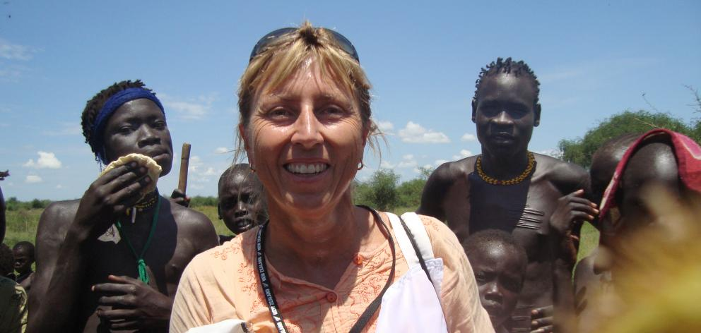 Felicity Gapes, pictured with some of the people she helped in the Jongili area of South Sudan. Her work in the country included developing a first aid programme for South Sudan Red Cross. Photo: Supplied