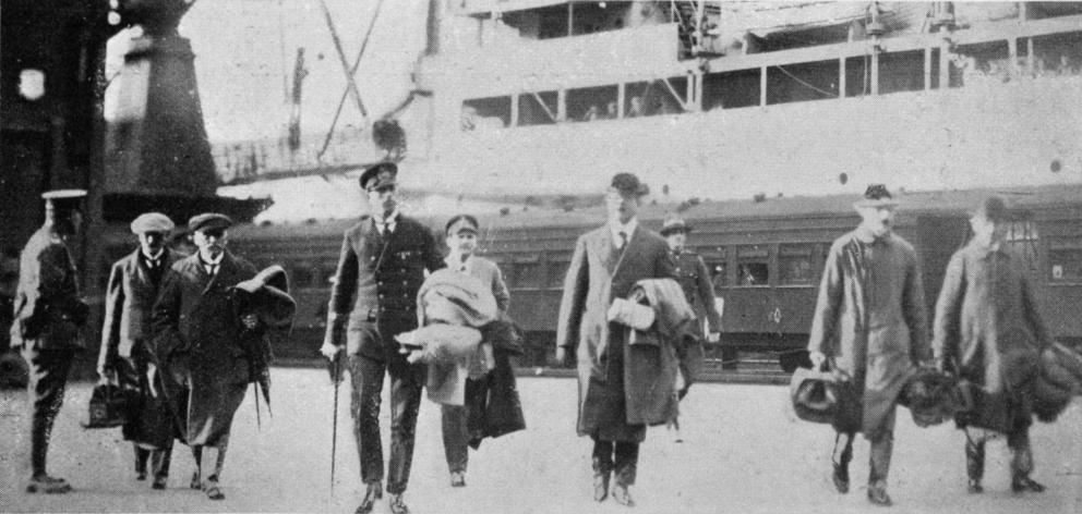 The German captain of the raider See Adler, Count von Luckner (in uniform), Dr Schultz, the ex...