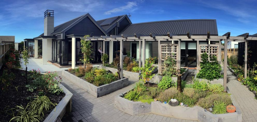 Surrounded by garden, this Dunedin home is on the former grounds of Corstorphine School. PHOTOS:...
