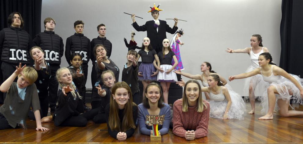 Logan Park High School pupil directors (centre, from left) Olivia Bradfield (17), Linea Simons (17) and Josie Baughen (16) celebrate with the cast after winning the inaugural Otago and Southland Showquest in Invercargill. PHOTO: GERARD O'BRIEN
