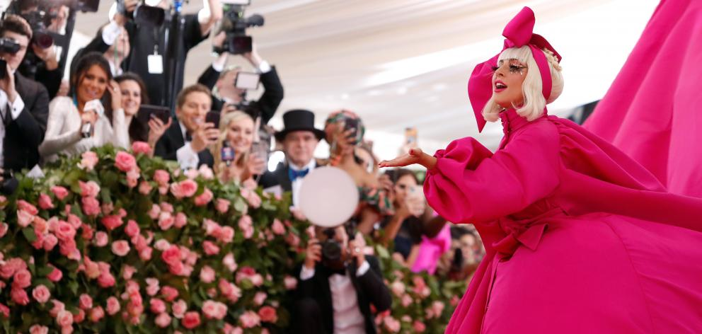 Pop superstar Lady Gaga made a grand entrance at New York's annual Met Gala on Monday, wearing a voluminous bright pink dress. Photo: Reuters