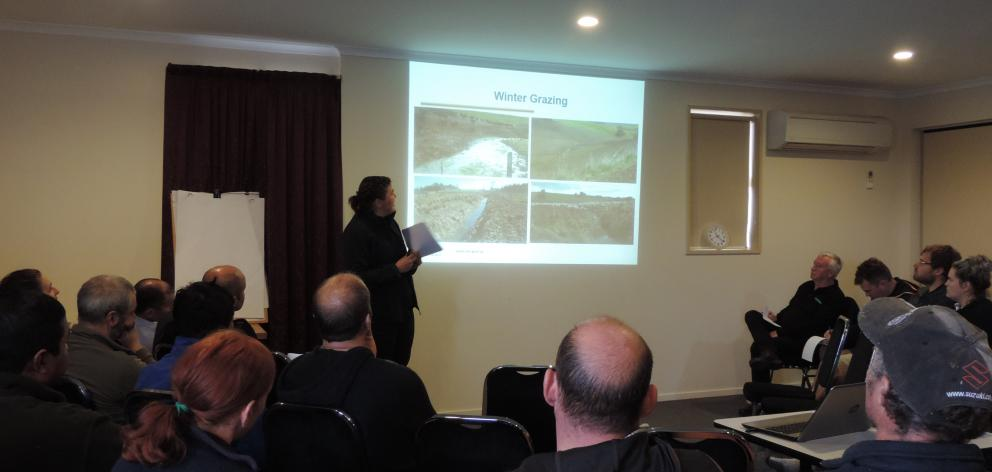 Otago Regional Council rural liaison and support officer Nicole Foote shows photographs of winter grazing causing unacceptable runoff. Photo: Sally Brooker