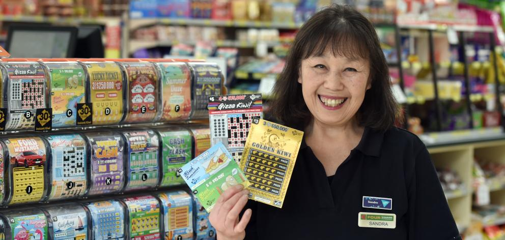 Caversham Foodmarket and Lotto store owner Sandra Shum is celebrating the 30th anniversary of Instant Kiwi after selling thousands of the scratchie tickets over the past three decades. Photo: Peter McIntosh