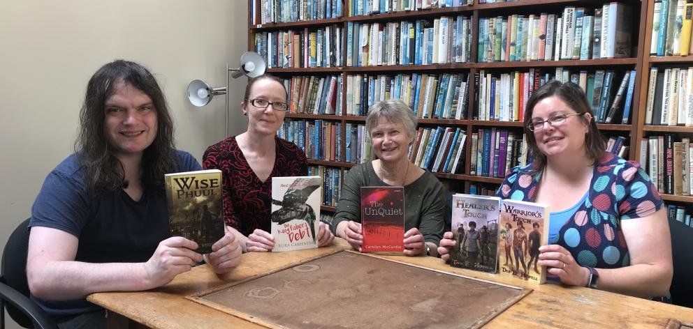 Founding members of the Dunedin Speculative Fiction Writer's Group, (from left) Daniel Stride, Kura Carpenter, Carolyn McCurdie, and Debbie Howell gather for one of their regular meetings at the Athenaeum Library. Photo: Mark McCabe