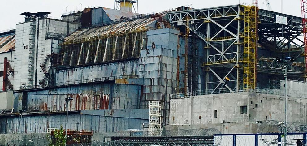 The crumbling sarcophagus that covered the remains of the ill-fated reactor No4, seen here not...