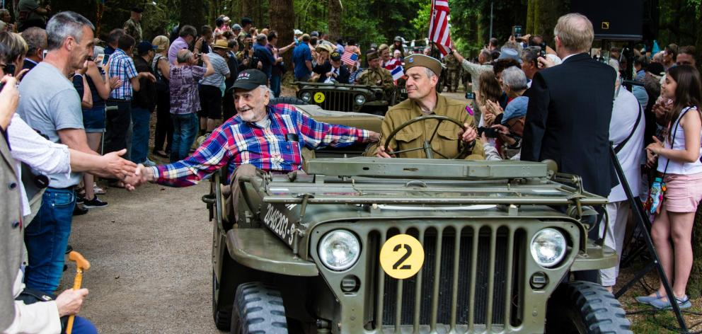 World War 2 veterans are greeted by a crowd at the 3rd Infantry Division Old Hickory memorial ceremony in Mortain, Normandy, before the 75th anniversary of the D-Day landings. Photo: Reuters