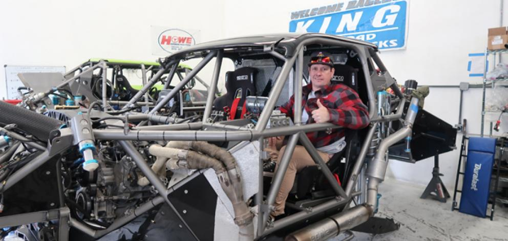 Phil 'LP' Casey at the wheel of his race truck while being reassembled in Mexico last month. Photo: Supplied