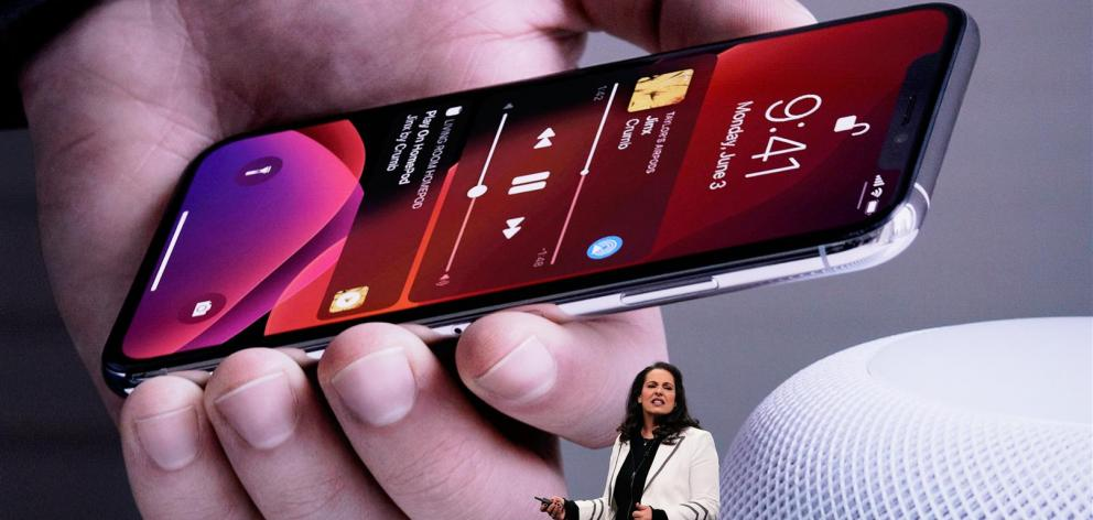 """The latest version of its iPhone operating software, iOS 13, manages to offer both privacy features and a """"dark mode"""" for the screen — a feature already available on Macs. Photo: Reuters"""