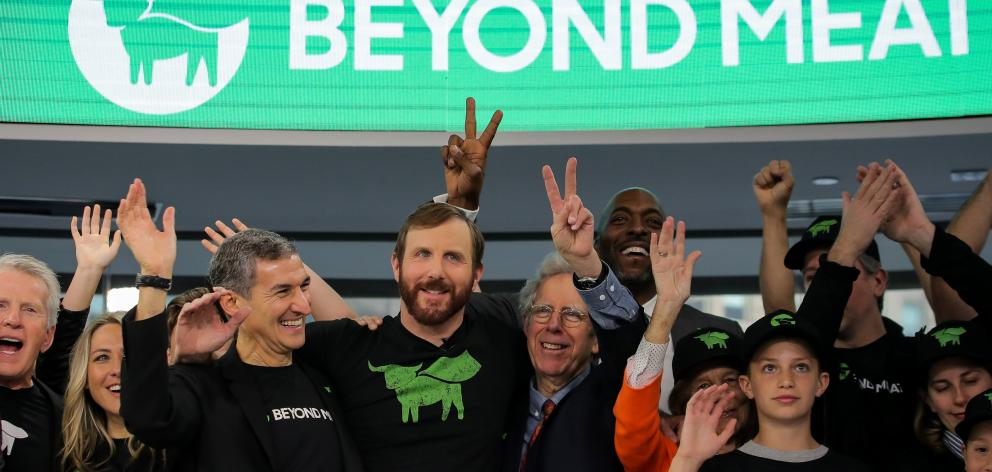 Ethan Brown, founder and chief executive of beyond Meat. and guests. ring the opening bell to...