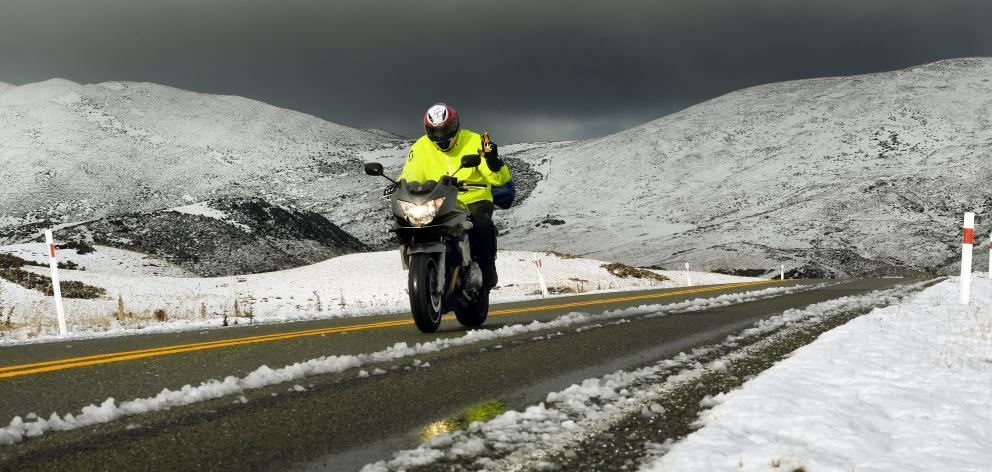 A motorcyclist gives a warm wave in chilly conditions on the Pigroot as he makes his way to the...