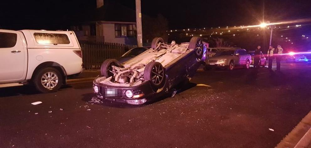 A car rolled after hitting two parked cars in Calton Hill early this morning. Photo: Kris Campbell