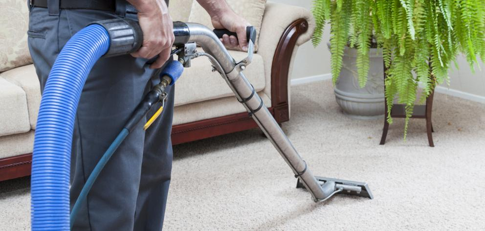 Professional carpet cleaners and vacuum. Photo: Getty Images