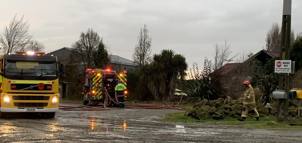 Firefighters battled a blaze north of Invercargill this afternoon. Photo: Abbey Palmer
