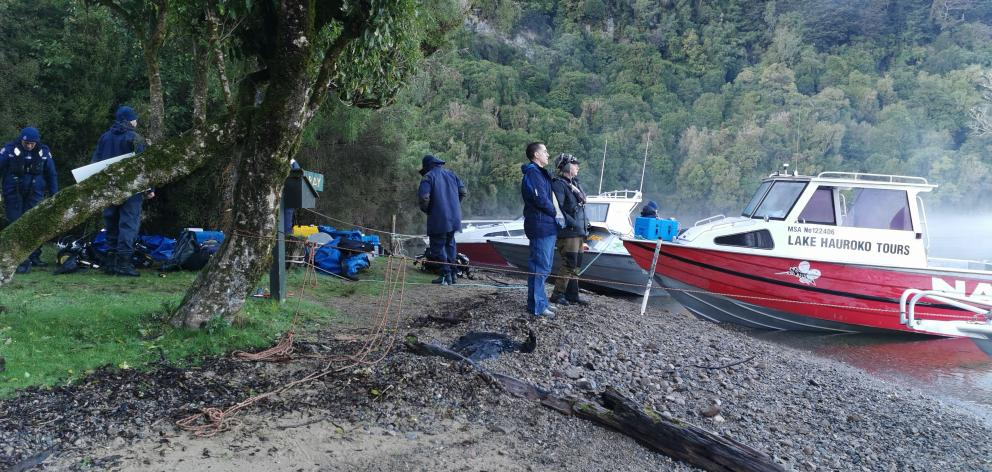 Police National Dive Squad and SAR squad members preparing for search at Teal Bay Hut Lake Hauroko. Photo: Supplied