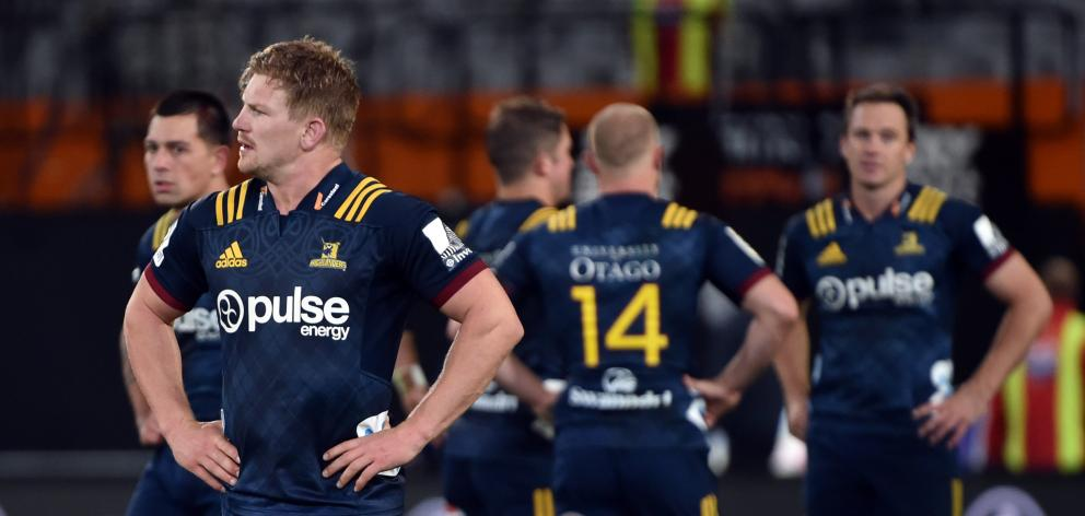 Highlanders flanker James Lentjes and team-mates are dejected after losing to the Hurricanes at Forsyth Barr Stadium in April. Photos: Peter McIntosh