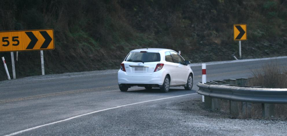 Vehicles cross the centre line on to the wrong side of the road near the Roaring Meg yesterday....