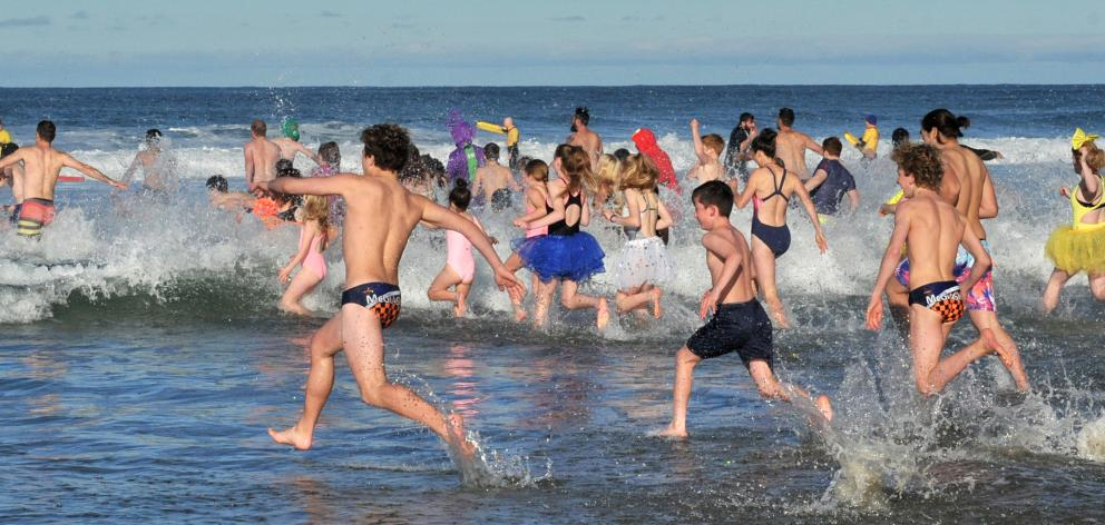 "Swimmers brave a ""refreshing"" dip. Photos: Christine O'Connor"