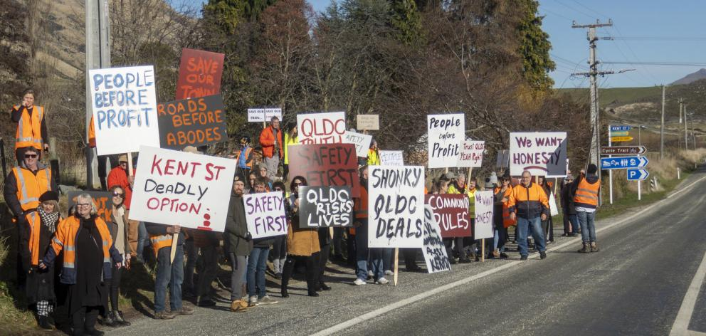 Kingston residents armed with placards called for ban on construction traffic from using the town...