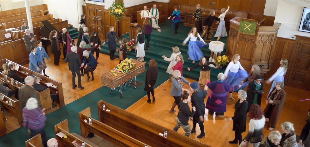 People express their love of movement at Shona MacTavish's funeral at Knox Church yesterday. Photo: Stephen Jaquiery