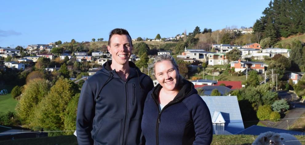 Shaun and Jess Brown, of Dunedin, are searching for a rental property to buy and joining the scores of people attending open homes. Photo: Shawn McAvinue