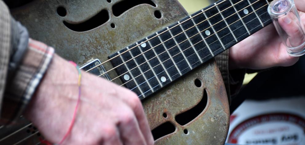 Italian guitarist Alessio Magliocchetti plays in Royal St.