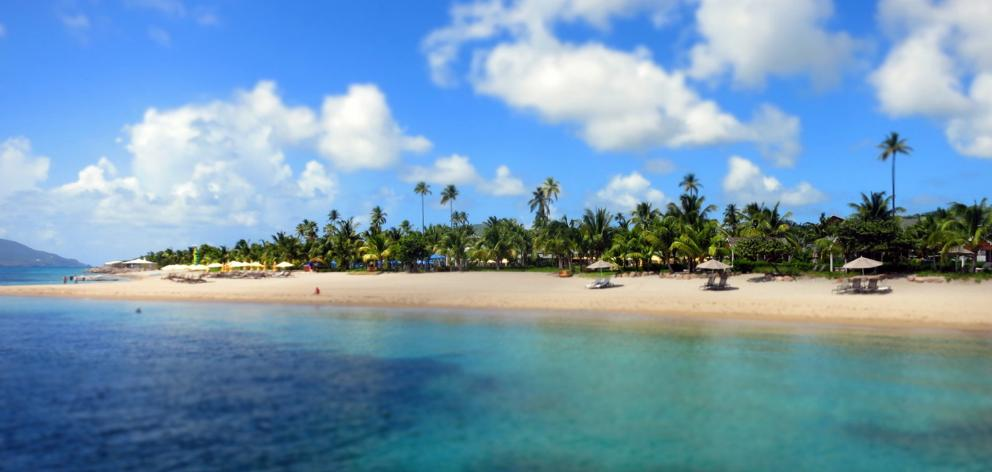 Pinney's Beach, the largest on Nevis, runs past the recently refurbished Four Seasons Resort....