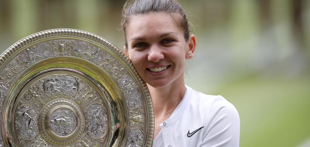 Simona Halep poses with the trophy after her Wimbledon victory. Photo: Reuters