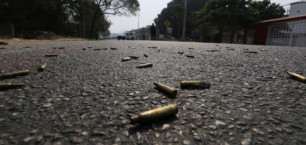 Bullet casings lie on the street near a crime scene in Acapulco. Photo: Reuters