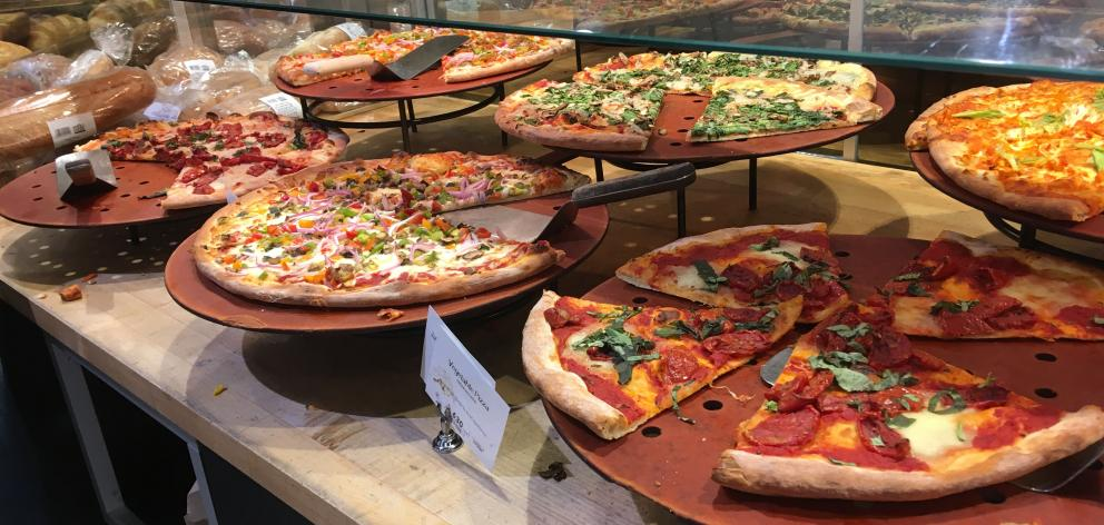 Pizza by the slice is ready for the taking at the Wholefoods Market, on South Grand Avenue. Photo: Pam Jones