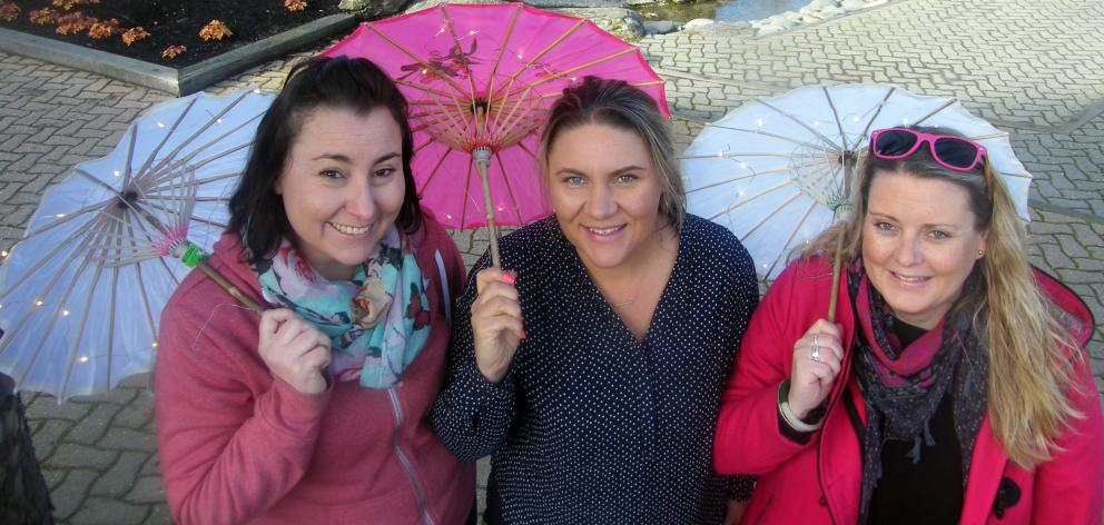 Organisers of Cromwell's Light Up Winter (from left) Marion Low, Brigitte Tait and Gretchen Nightingale get into the spirit in preparation for Saturday's event. Photo: Adam Burns