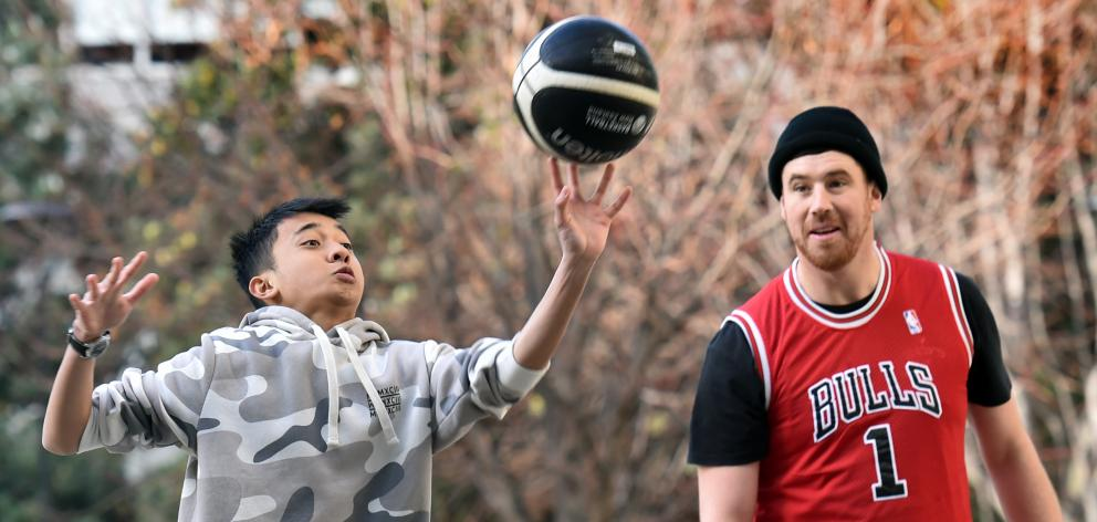 University of Otago student Rashiid Rosland shoots while Andrew James looks on, at one of the...