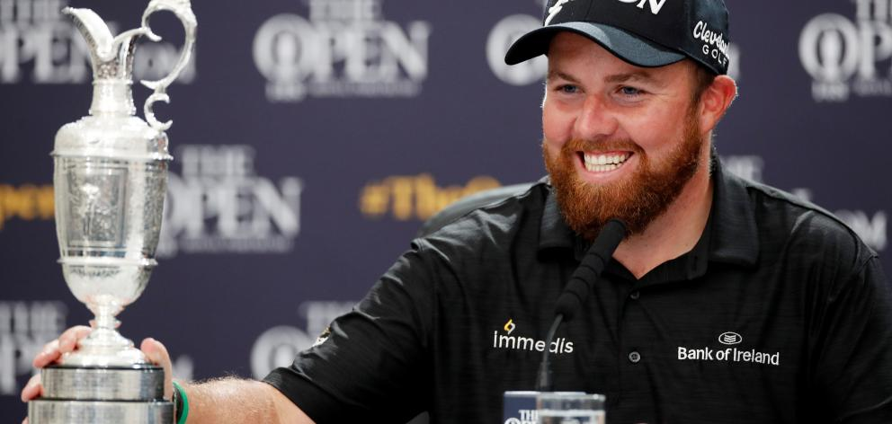 Republic of Ireland's Shane Lowry with the Claret Jug trophy in a press conference after winning The Open Championship. Photo: Reuters
