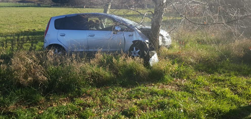 A car came off the road and hit a tree in Mosgiel today. Photo: Maddy Horn