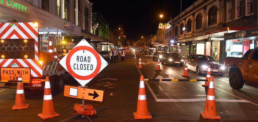 Workers start to close part of George St northbound yesterday. Photo: Peter McIntosh