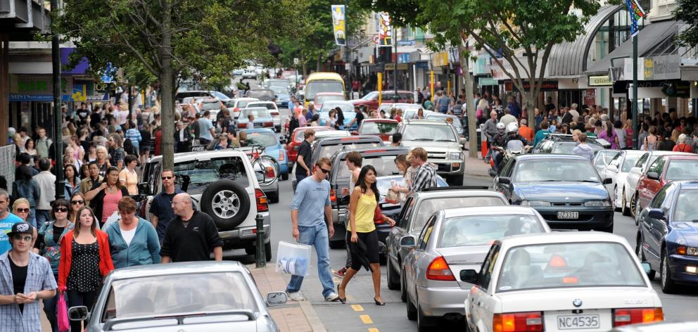 George St is a nightmare of cars, near-empty diesel buses and frustrated pedestrians. PHOTO: ODT...