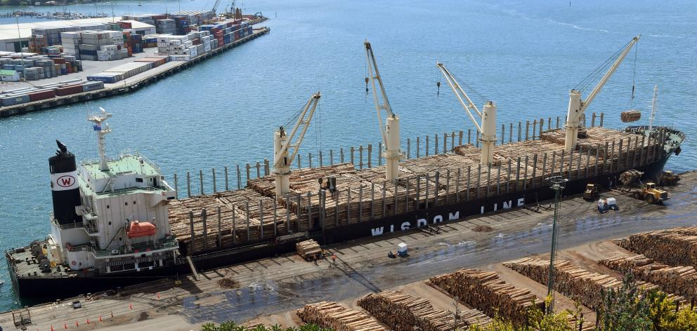 Logs  are loaded  on  Bunun Dynasty at Port Otago's Beach St wharf, Port Chalmers. Photo: Stephen Jaquiery