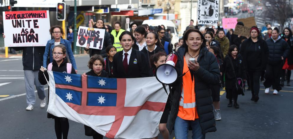 Dunedin protest co-ordinator Kylie Taggart at the head of yesterday's Hands Off Our Tamariki protest march in Dunedin. Photo: Gregor Richardson