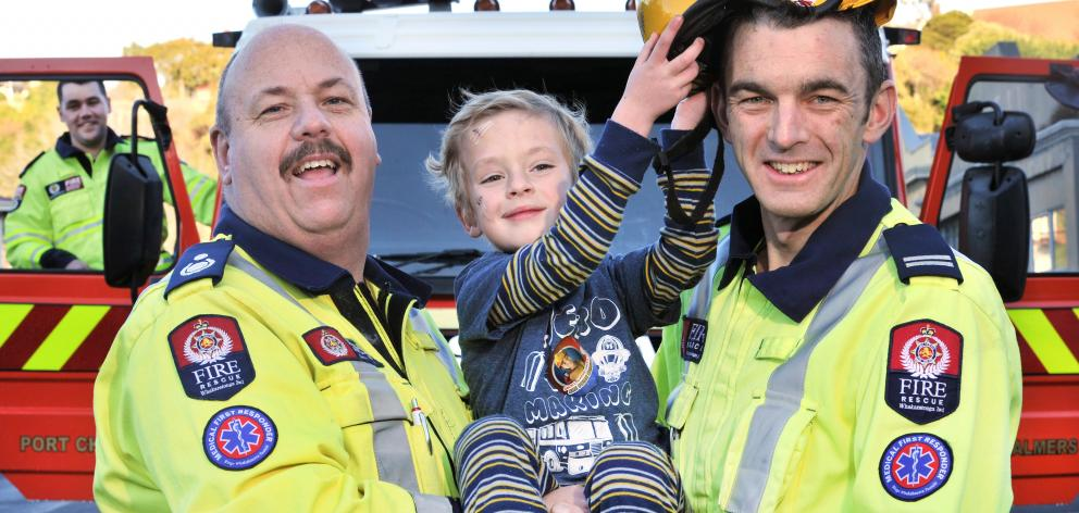 Reunited with the Port Chalmers good volunteer firefighters who came to his aid after he fell through a glass cabinet at his Careys Bay home is Charlie Cully and (from left) qualified firefighter Daniel Napier, Deputy Chief Fire Officer Cory White and Sen