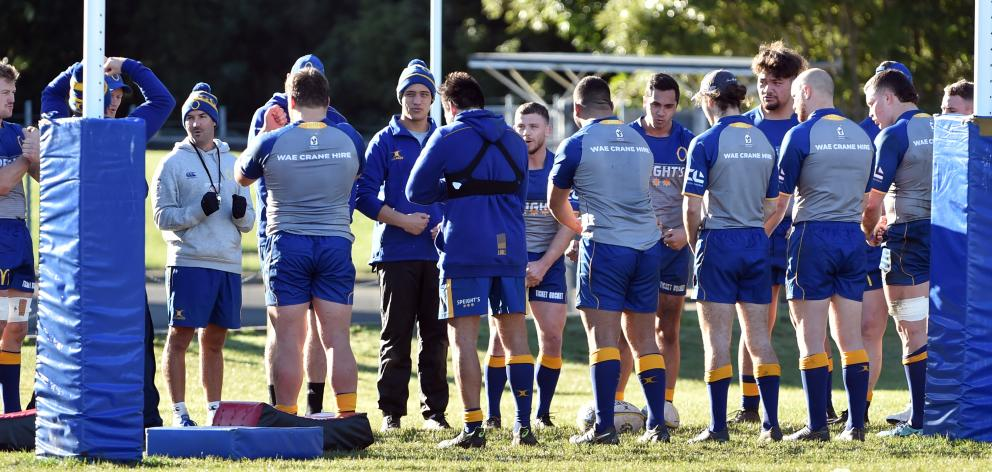The Otago team has a debrief after the captain's run at Logan Park yesterday. PHOTO: PETER MCINTOSH