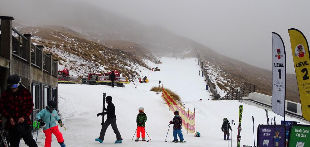 After weeks of delays, Treble Cone skifield finally had its open day yesterday, and while the conditions may not have been the best, about 1000 skiers and snowboards headed up the mountain. Photo: Kerrie Waterworth