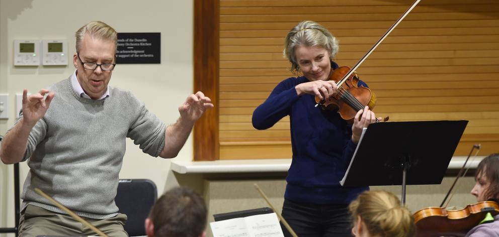 Violinist Tessa Petersen rehearses her solo with the Dunedin Symphony Orchestra and conductor Richard Davis at Hanover Hall. Photo: Gregor Richardson