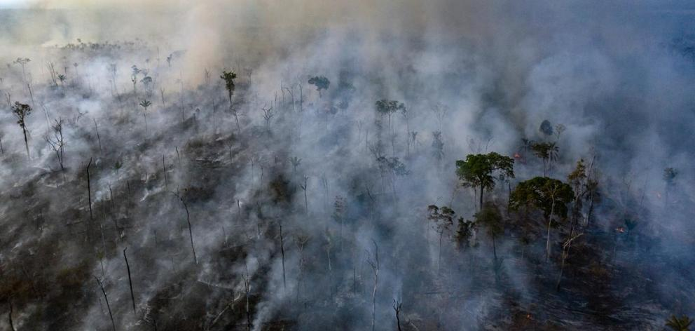 An aerial view of forest fire of the Amazon taken with a drone is seen from an Indigenous...