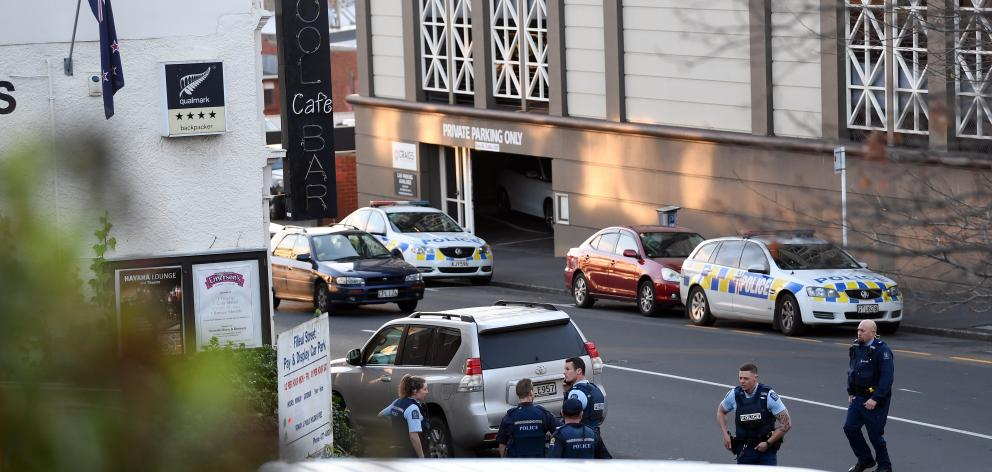 On Top Backpackers in Filleul St, Dunedin, before arresting a man on a parole recall warrant...